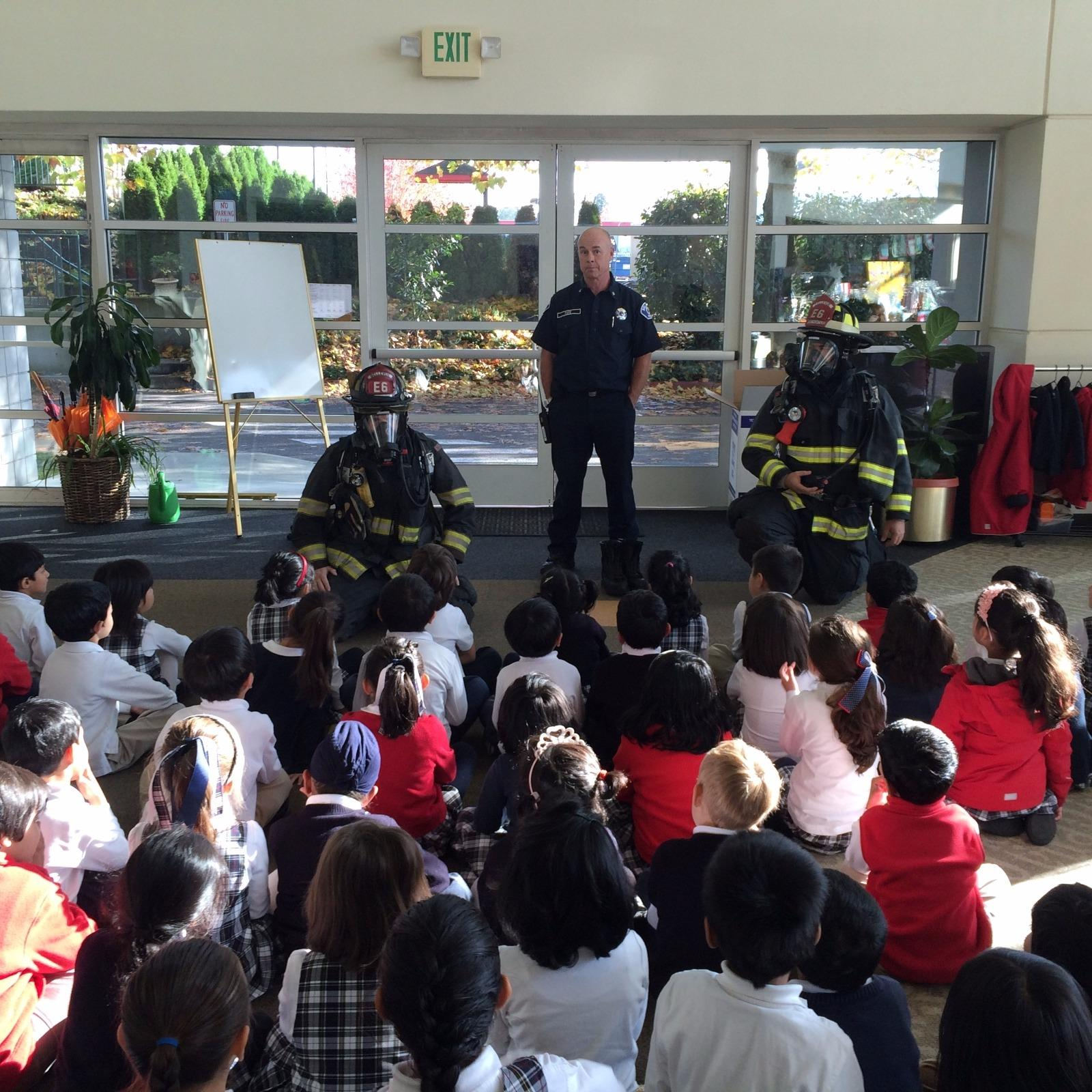 Image of firefighters presenting to a kindergarten class