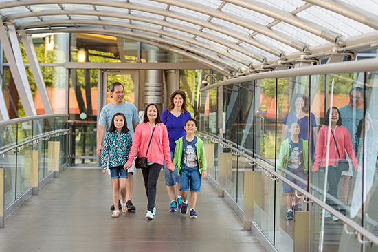 A family walks one of Bellevue's downtown skybridges.