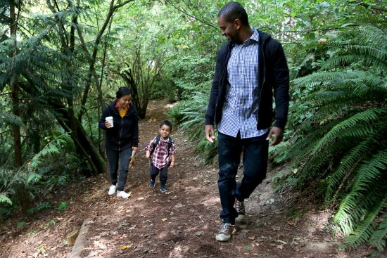 A family walks one of the trails at Mercer Slough