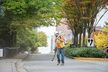 image of street maintenance worker on city street