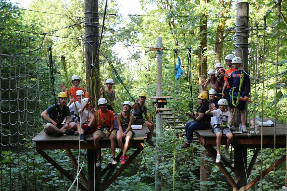 Participants on the high ropes course at the Bellevue Challe