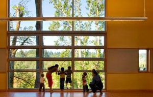 Families peer out at a window at the Mercer Slough Environme