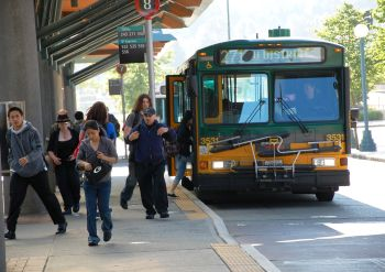 image of bus and riders at downtown transit center