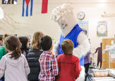 Students gather around the Carbon Yeti, Bellevue's conservation mascot, at the awards ceremony Dec. 12.