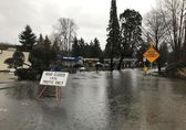 Water over roadway and closure signs