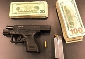 Confiscated gun and cash