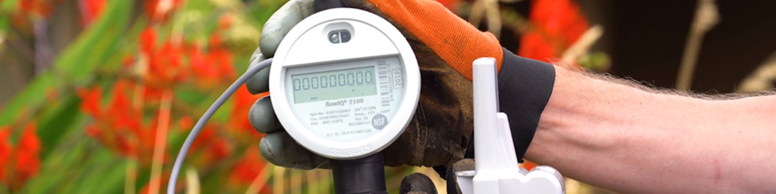 Hand holding a smart water meter ratio transmitter device
