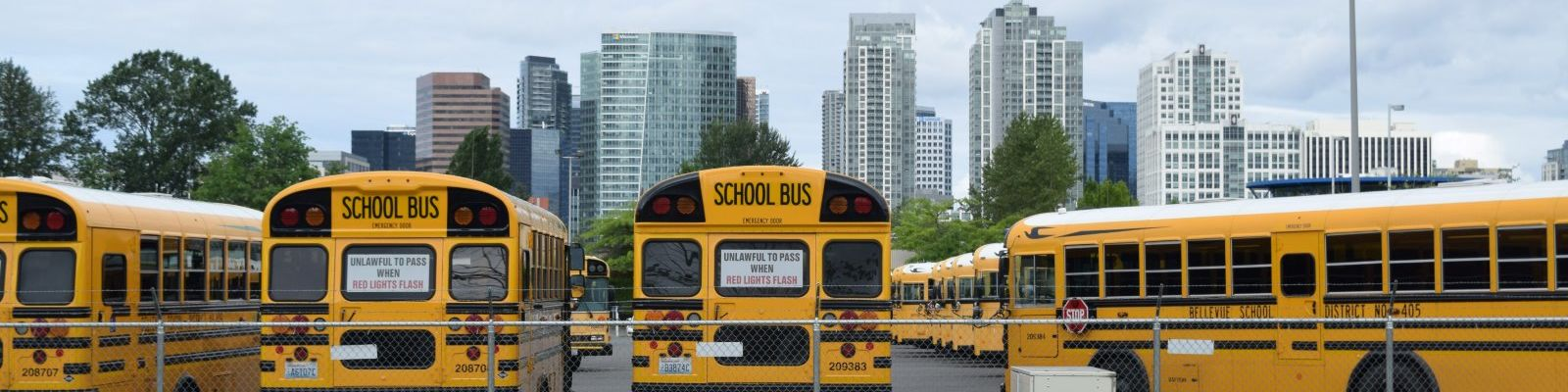 school-buses-downtown-skyline-1600x400.jpg