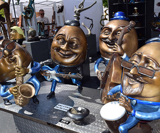 A band of bronze statuettes are on sale at the arts fairs in 2017.
