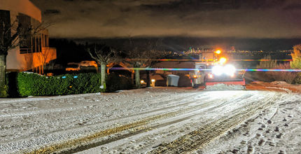 A snowplow clears a neighborhood street in South Bellevue.