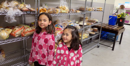 Girls pick up food at the Hopelink food bank.