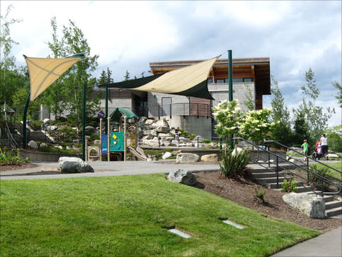 Lewis Creek Park Visitor Center - play area and back of buil