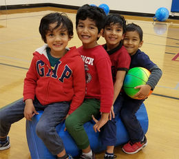 Crossroads Community Center - four Pre-K kids in gym