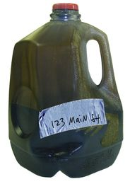 Used motor oil in milk jug