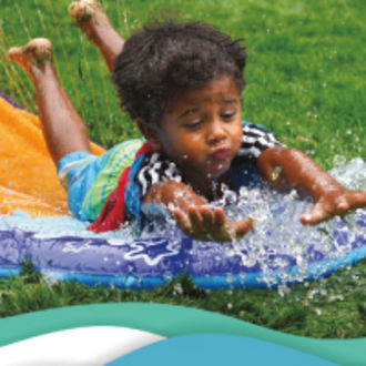 Child sliding on water slide, cover of 2020 summer day camp brochure